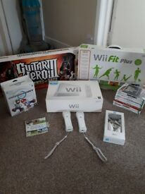 Nintendo Wii bundle- Wii Fit, Mario Kart, Guitar Hero and games
