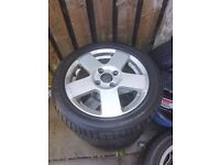 Ford Fiesta alloys with tyres.