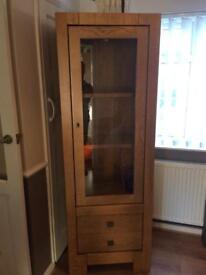 Tall light Oak display cabinet