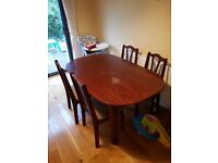 Small dining table and four chairs for collection.