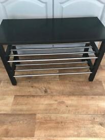 Black IKEA bench and shoe rack