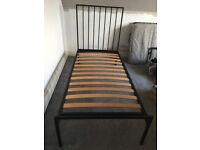 Two single beds. Habitat Lucia black metal bed frames