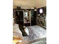 2 black gloss wardrobes buyer to collect £60 for the pair