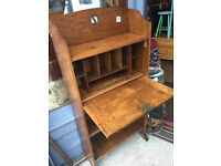 Oak bookcase with fall front . In good condition. Free Local Delivery Size L 23in D 9in H 48in.