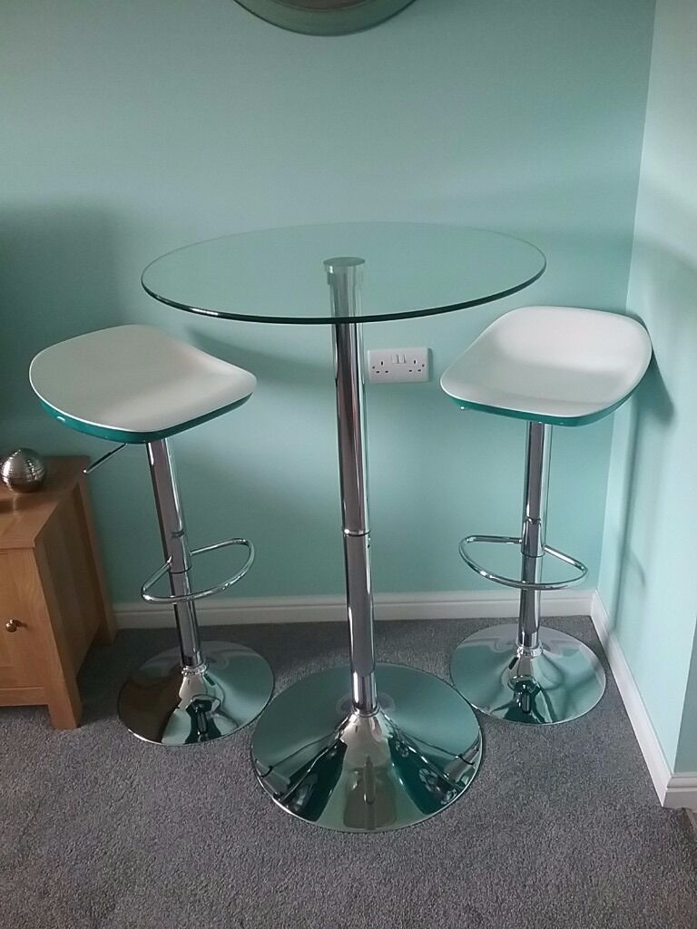 Contemporary round glass and silver kitchen bistro table and 2 teal ...
