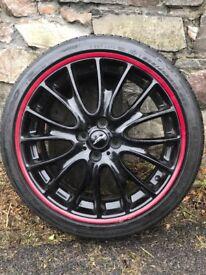 Genuine John Cooper Works 18 inch pinstripe wheels