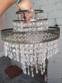 Antique brass effect tiered chandelier