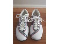 Ladies size 7 Nike Golf shoe.