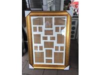 "36""x24"" gold wooden frame with multi mount"