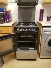 Gas cooker with high rised grill all working