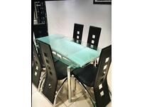 Glass dinning table 6 leather faux black chairs