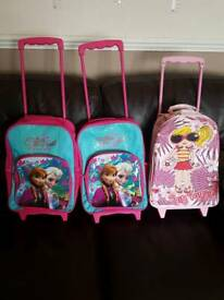 2 x frozen trolley bags. 1 bon voyage trolley bag