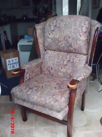 high backed winged armchair