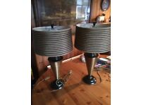 Pair of large gold and black table lamps .