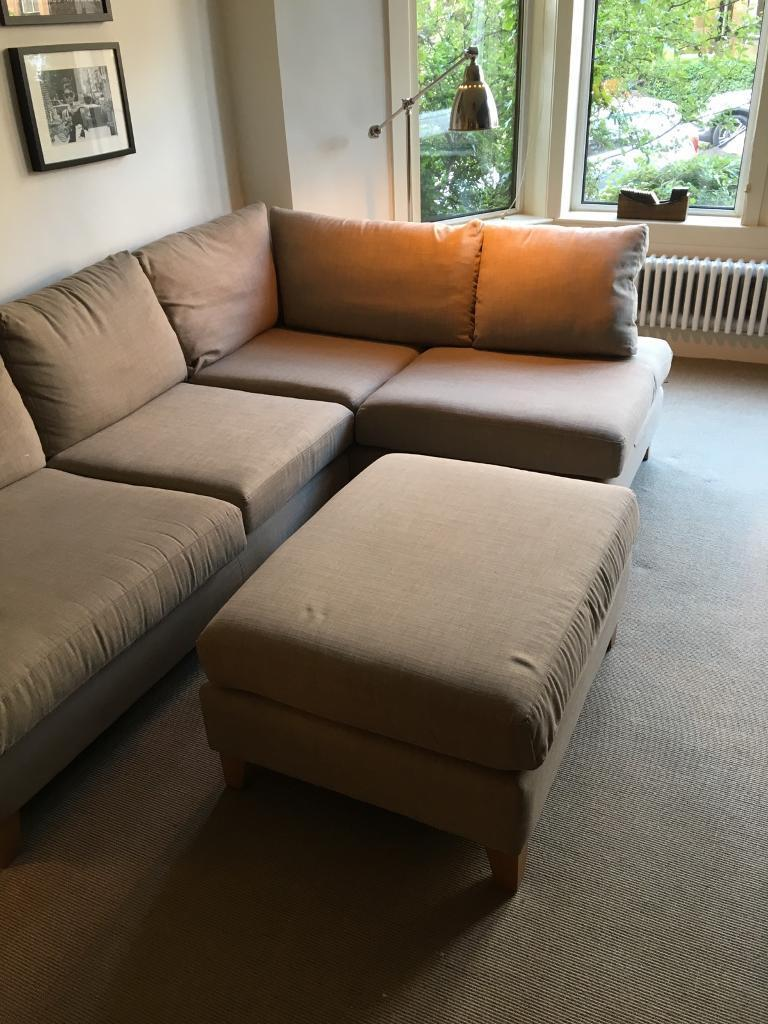 Modern corner sofa with footstool