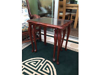 Nest of 2 Mahogany tables with glass tops