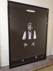 Glass picture frame photo of John Hurt central London
