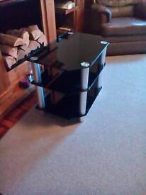 T.V. stand/unit black glass with silver legs 24ins.long.x20ins.high