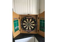 Harrows dart board in cabinet with two sets of darts, very good condition