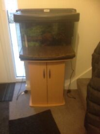 65 litre fish tank and stand for sale. Comes with filter, heater and gravel. Good condition