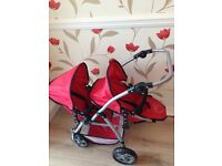 Dolls double red buggy