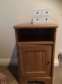 Small wooden unit with white trinket box attached.