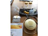 Medela swing electric breast pump and two bottles