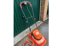 Flymo Lite 330 electric lawnmower in full working order. Long cable to suit medium sized garden.