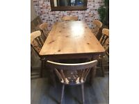 Great traditional farmhouse dining table with 6 solid wood chairs