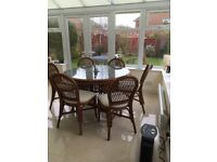 Conservatory dining round glass topped table and six upholstered chairs very good condition £140