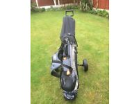 golf bag with clubs and trolley