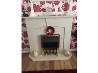 Electric fire & surround, all working order. Mark on top as seen in photo. Buyer to collect.