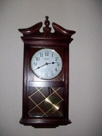 Retro dark wood pendulum wall cloock