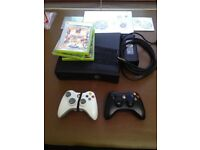 xbox 360 plus 2 controllers and games