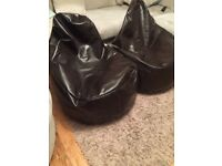 2 x large brown leather bean bags. Hardly used, in excellent condition.