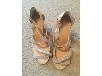 Pair of beige heeled shoe, size 7, never worn.