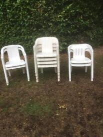 Eight stackable garden chairs
