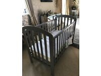 Grey cot for sale with mattress, excellent condition, barely been used
