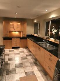 PWS Kitchen inc granite worktops and integrated AEG dishwasher and range oven