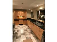PWS Kitchen inc granite worktops and integrated AEG dishwasher and range oven