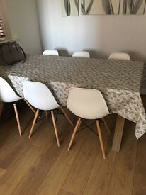 Eames inspired white and wood chairs