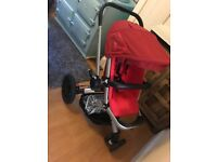 Red Quinny Buzz buggy/ pram/ travel system with extras