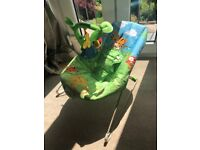 Baby bouncer nearly new- suitable from birth