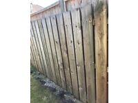 Fence boards free to anyone who can temove