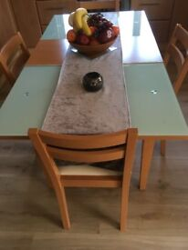 Dining table and 4 chairs. Glass with Beech Centre section