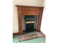 Antique tall decorative wooden fireplace surround