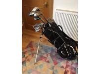 Golf clubs with Nike stand bag