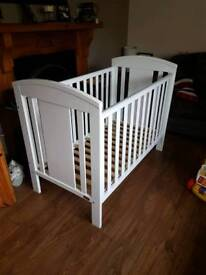 White BP baby cot/ mattress included.