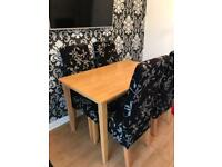 Beautiful light oak dining table and chairs