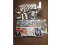 Nintendo Wii & games (Just Dance, Mario & Sonic, etc)